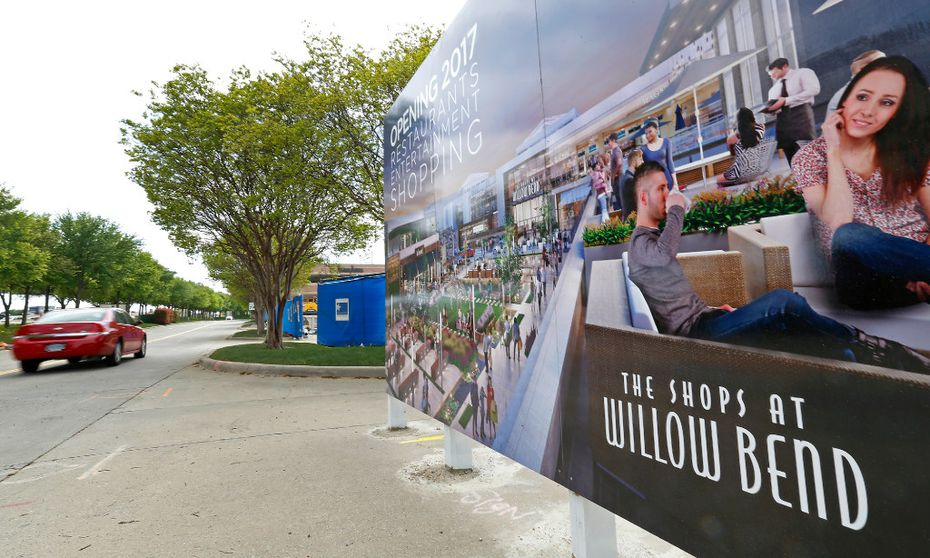 A car passes by a rendering sign at the renovation project site of The Shops at Willow Bend in Plano, Texas, Monday, March 27, 2017. (Jae S. Lee/The Dallas Morning News)