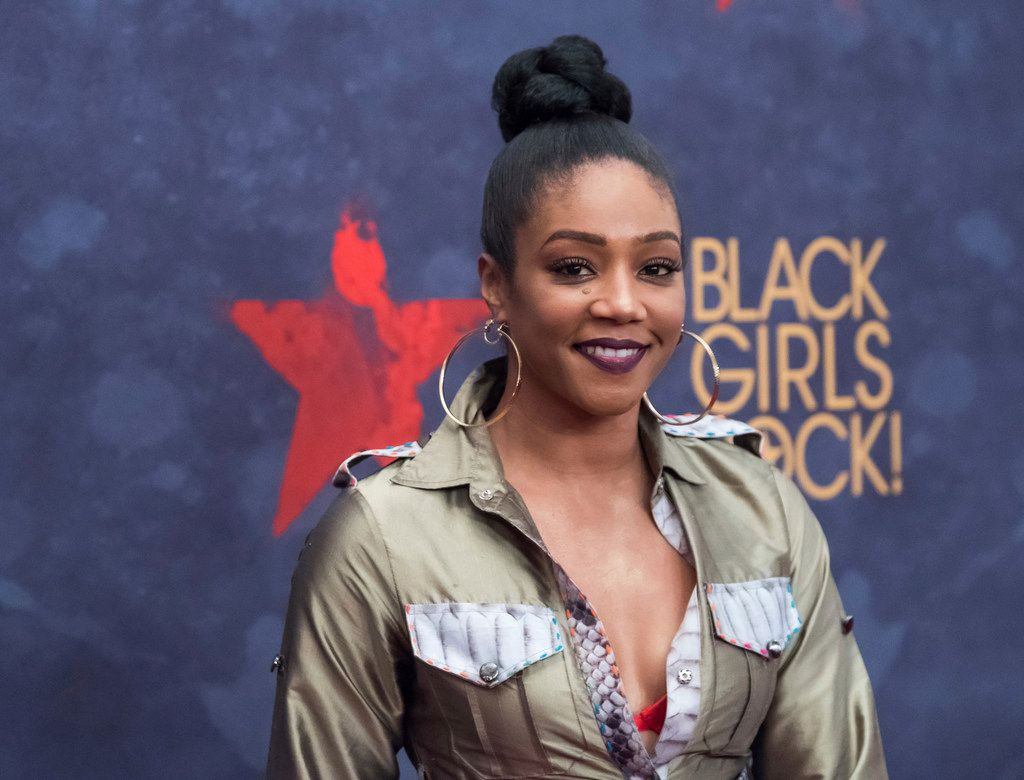 "In this Aug. 5, 2017, photo, Tiffany Haddish attends the Black Girls Rock! Awards at the New Jersey Performing Arts Center in Newark, N.J. Actress and comedian Haddish is having a full-circle moment. The breakout star of the summer movie hit ""Girls Trip"" launched her career on ""Def Comedy Jam,"" the long-running HBO series spotlighting black comics, and now she's appearing on its 25th anniversary tribute."