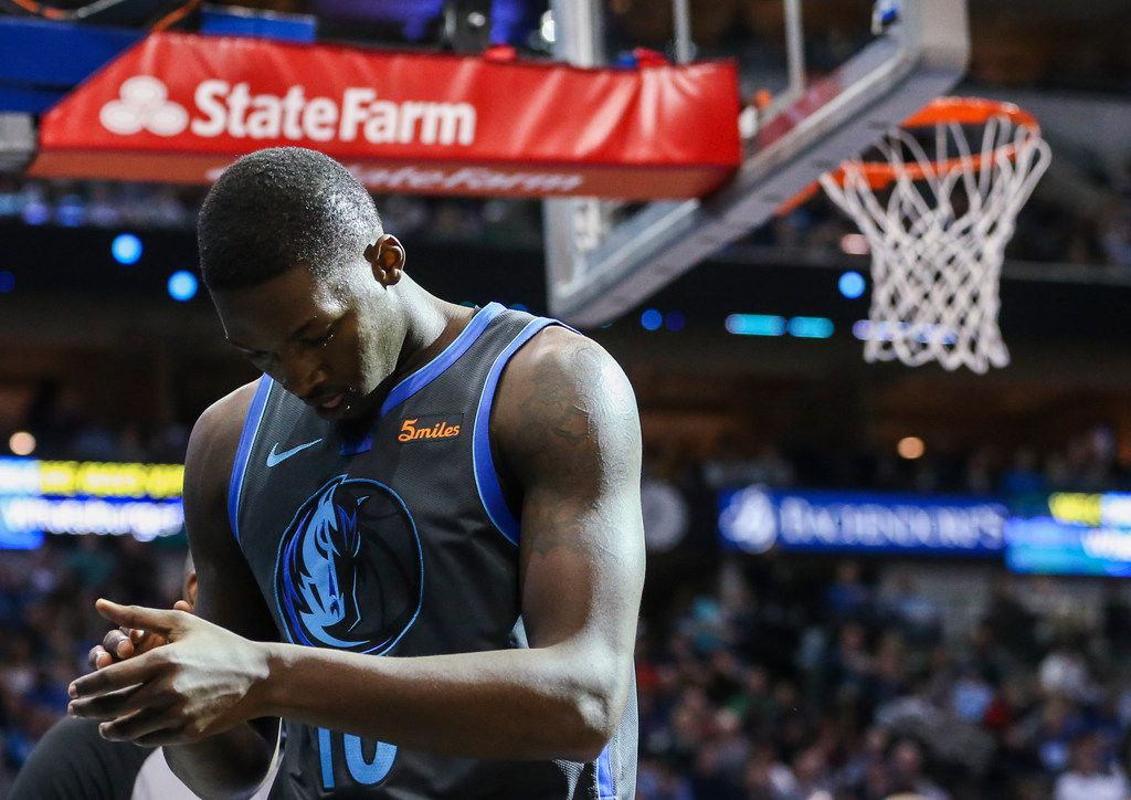 Dallas Mavericks forward Dorian Finney-Smith (10) reacts to a play during the second half a matchup between the Dallas Mavericks and the Houston Rockets on Sunday, March 10, 2019 at the American Airlines Center in Dallas. (Ryan Michalesko/The Dallas Morning News)