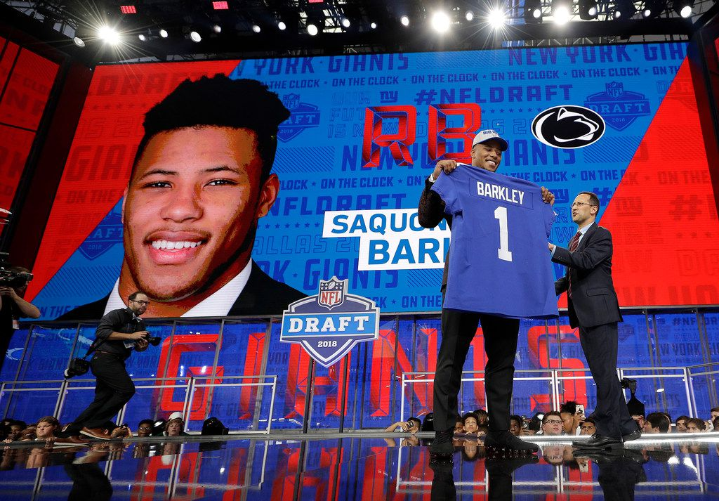 Penn State's Saquon Barkley poses after being selected by the New York Giants during the first round of the NFL football draft, Thursday, April 26, 2018, in Arlington, Texas. (AP Photo/David J. Phillip)