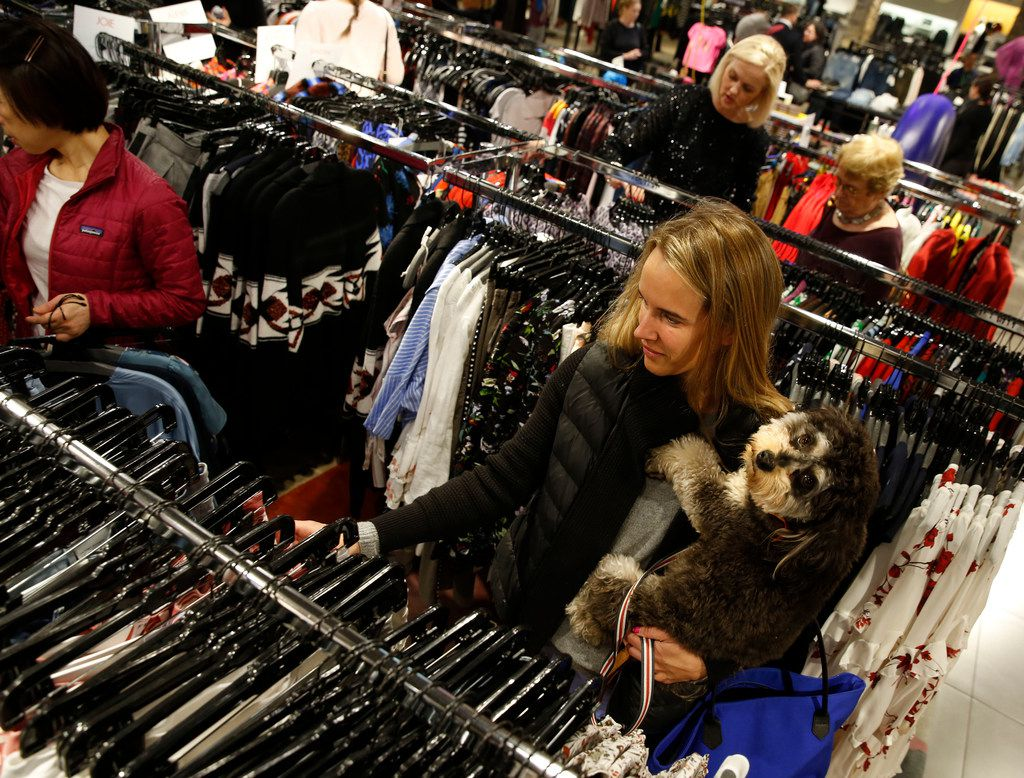 Alexandra Suich shops with her dog Theo at Neiman Marcus in the NorthPark Center in Dallas on Nov. 23, 2018. (Nathan Hunsinger/The Dallas Morning News)