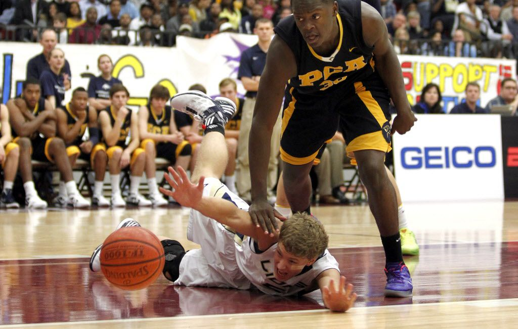 Grace Prep's Zach Ghormley (5) tries to recover the ball against Prestonwood Christian's Julius Randle (30) during a boys basketball game at Lewisville High School on Thursday, December 15, 2011. (Lara Solt/The Dallas Morning News)