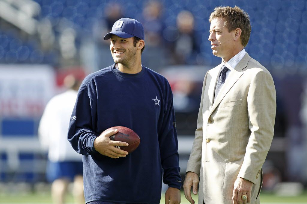 Dallas Cowboys quarterback Tony Romo (left) talks with Fox sports announcer Troy Aikman (right) before an NFL football game against the New England Patriots  Sunday, October 16, 2011 at Gillett Stadium in Foxboro,  Massachusetts. The Patriots won the game, 20-16.  (AP Photo/James D Smith) 03242012xSPORTS 10202013xSPORTS