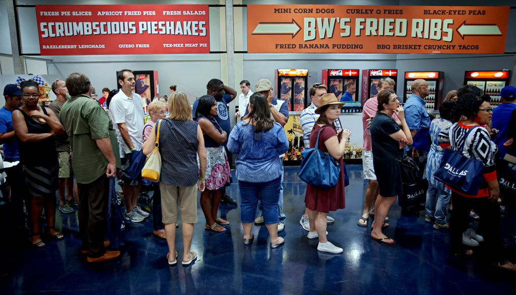 People wait in line for their turn to tries entries during the 2016 Big Tex Choice Awards Sunday, August 28, 2016 at Fair Park in Dallas. The annual event, held ahead of the State Fair of Texas, recognizes the best fried foods entered into consideration for sale at the fair. (G.J. McCarthy/The Dallas Morning News)