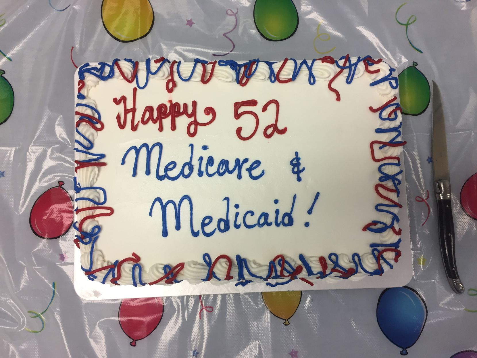 A birthday cake for Medicare and Medicaid sits on a table at the meeting of the Texas Alliance for Retired Americans on Wednesday.