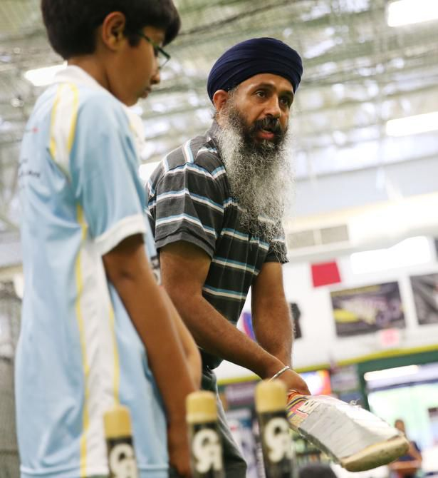 Seven-year-old Aansh Jha of Plano observes as Kuljit-Singh Nijjar, who started the league, coaches.