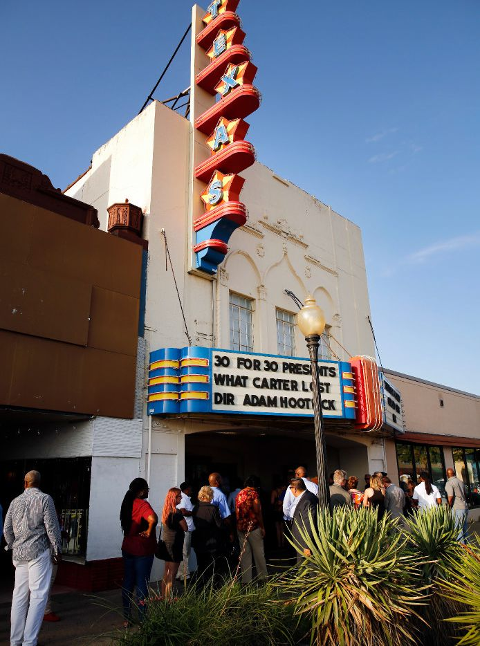 People wait to go into the Texas Theatre to see  the premier of What Carter Lost, an ESPN documentary about the 1988 Carter football team shown at the Texas Theatre in 2017.