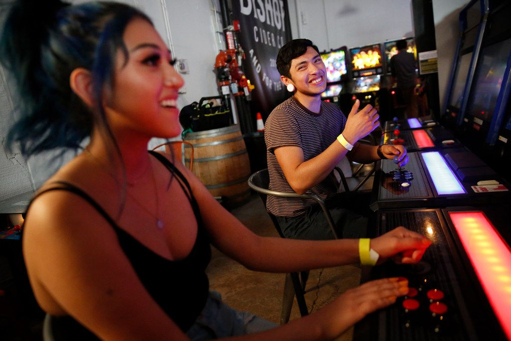 Thomas Valenciana reacts after winning a video game against Kayla Bugarin at Cidercade in Dallas.