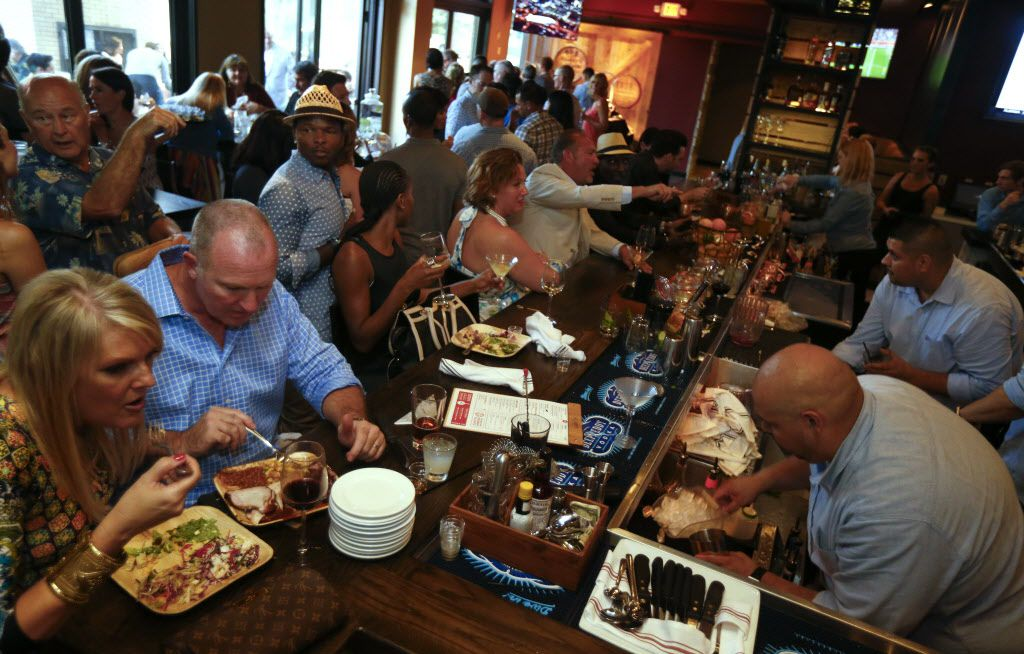 People eating during the opening party of Hickory, Kent Rathbun's new restaurant in Plano on June 13, 2015