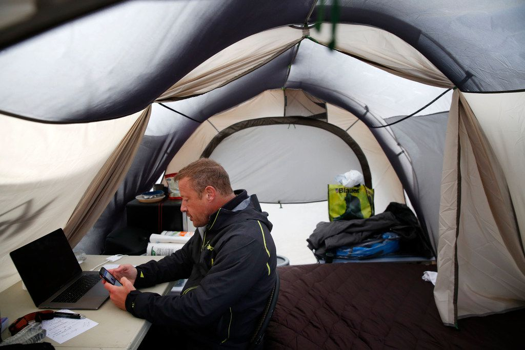 Todd Phillips, founder and director of the Last Well, prepares to record a Facebook Live video from inside his tent on his wooden barge on Lake Ray Hubbard in Rockwall.