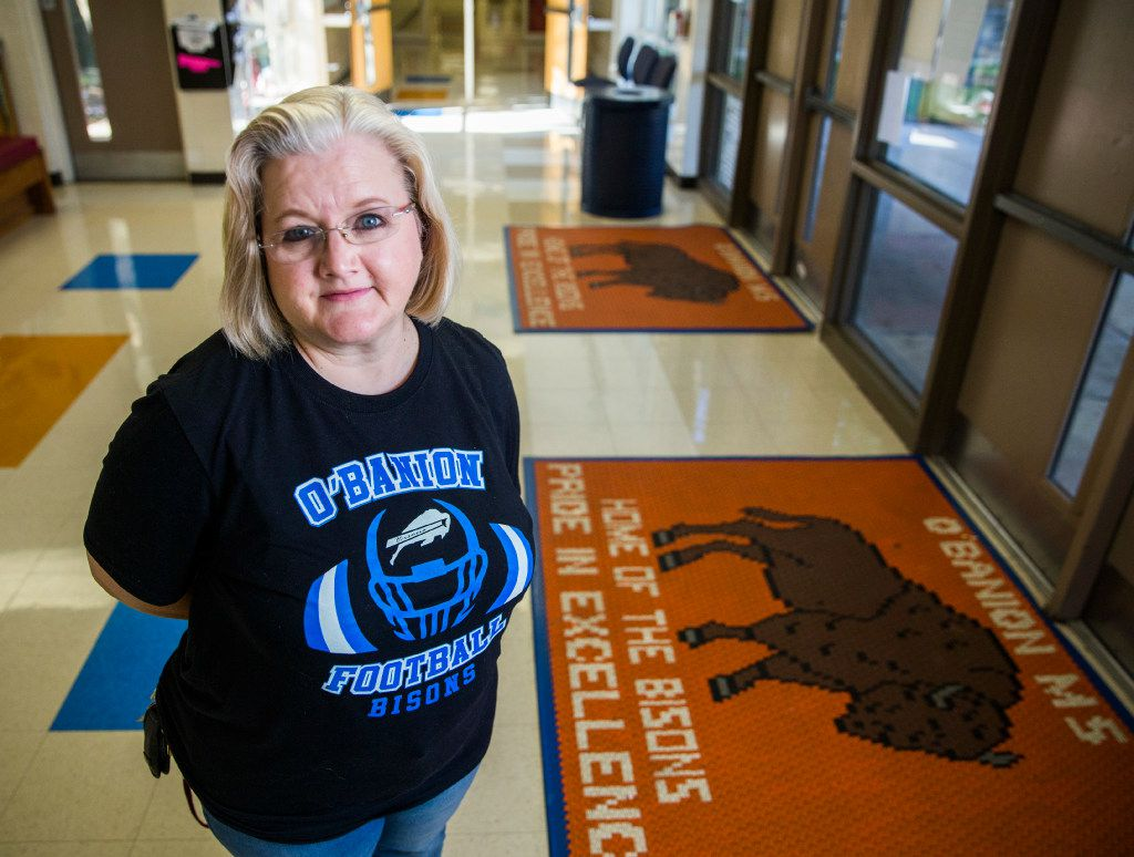 U.S. history teacher Dawn Cardenas poses for a portrait in the lobby of O'Banion Middle School in Dallas. (Ashley Landis/Staff Photographer)