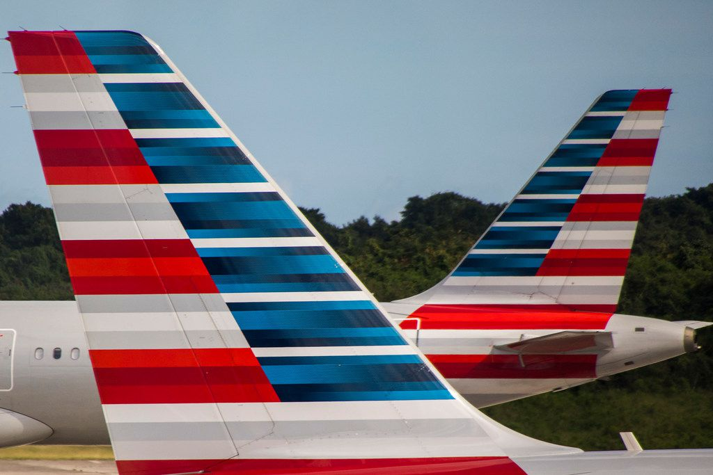 An American Airlines plane taxis away from another parked at the gates of Las AmŽricas International Airport on Sunday, Jan. 21, 2018, in Santo Domingo, Dominican Repbulic.  (Smiley N. Pool/The Dallas Morning News)