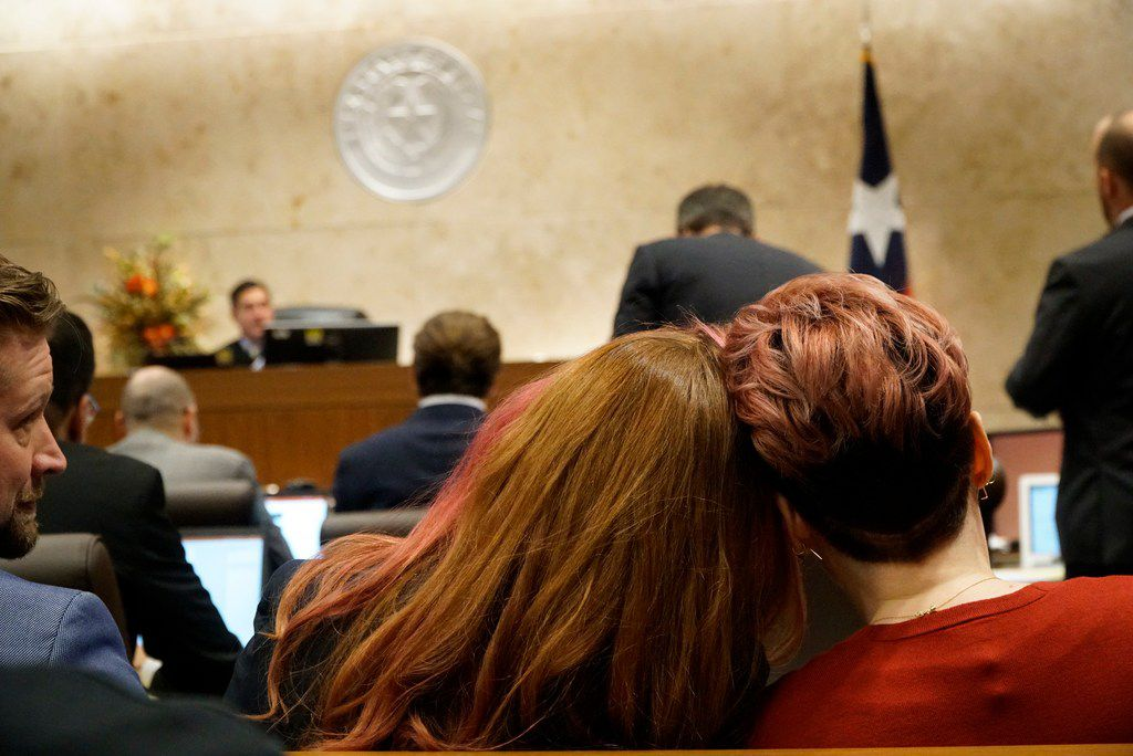 Jamie Marchi and Monica Rial comforted each other at a hearing earlier this month in the Tarrant County courtroom of Judge John Chupp. The judge ordered both sides in the defamation lawsuit into mediation Tuesday.