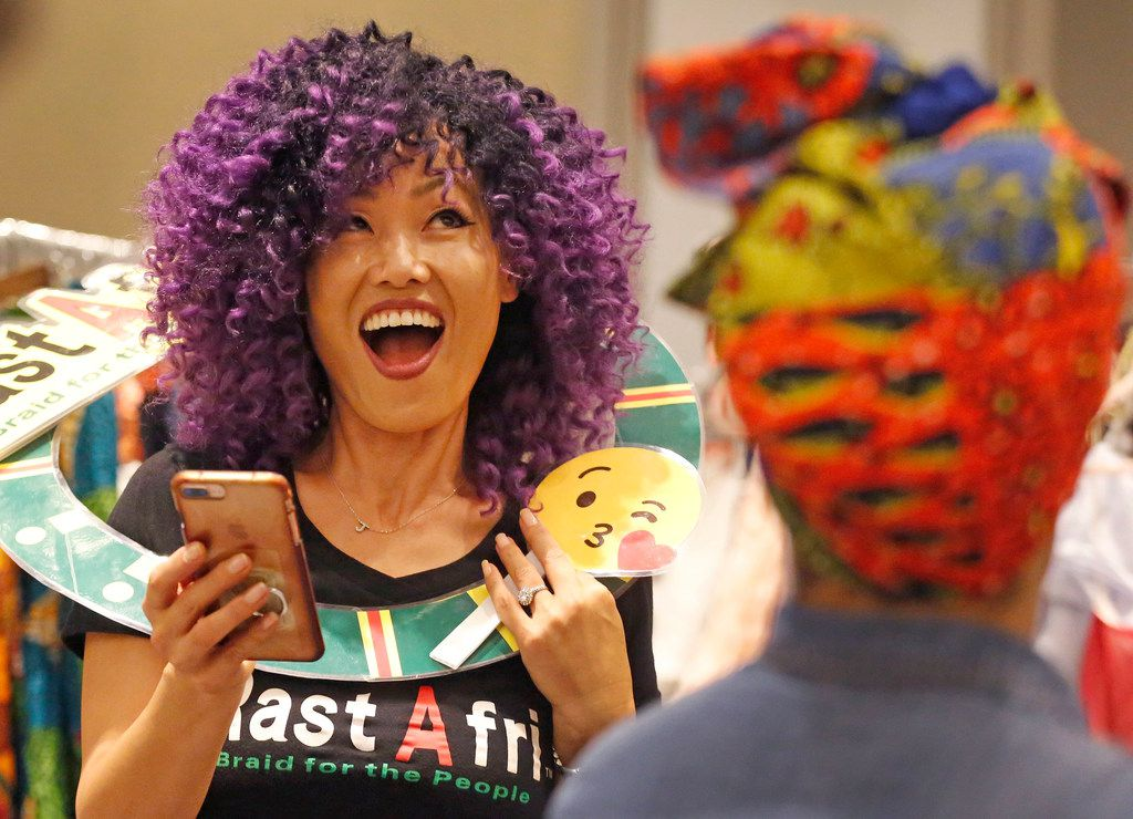 Jinah Chung, center, is pictured at the RastAfri booth during the Afrolicious Hair and Beauty Expo at the Dallas Westin Park Central in north Dallas on Sunday, August 5, 2018.