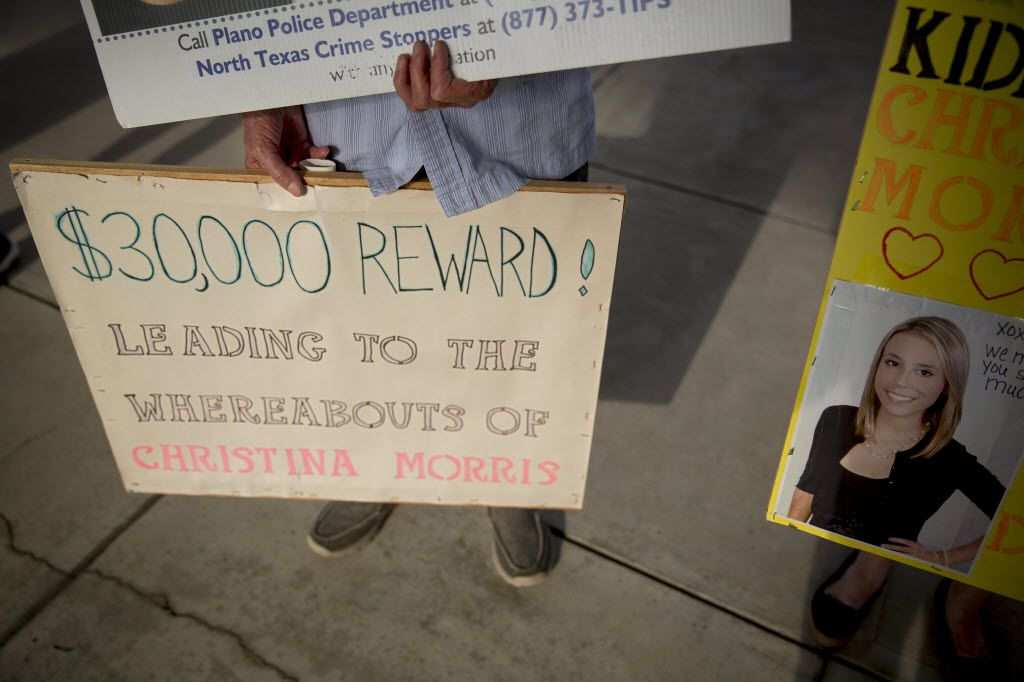 Signs during a protest at the Collin County Jail advertise the reward for information on the whereabouts of Christina Morris.