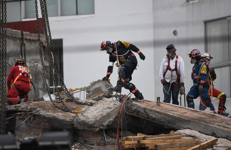 Rescuers continue to search for victims in the rubble of the collapsed Alvaro Obregon building. Two weeks after an earthquake that killed more than 300 people, a shaken Mexico was torn between trying to get back to normal and keeping up an increasingly hopeless search for survivors.