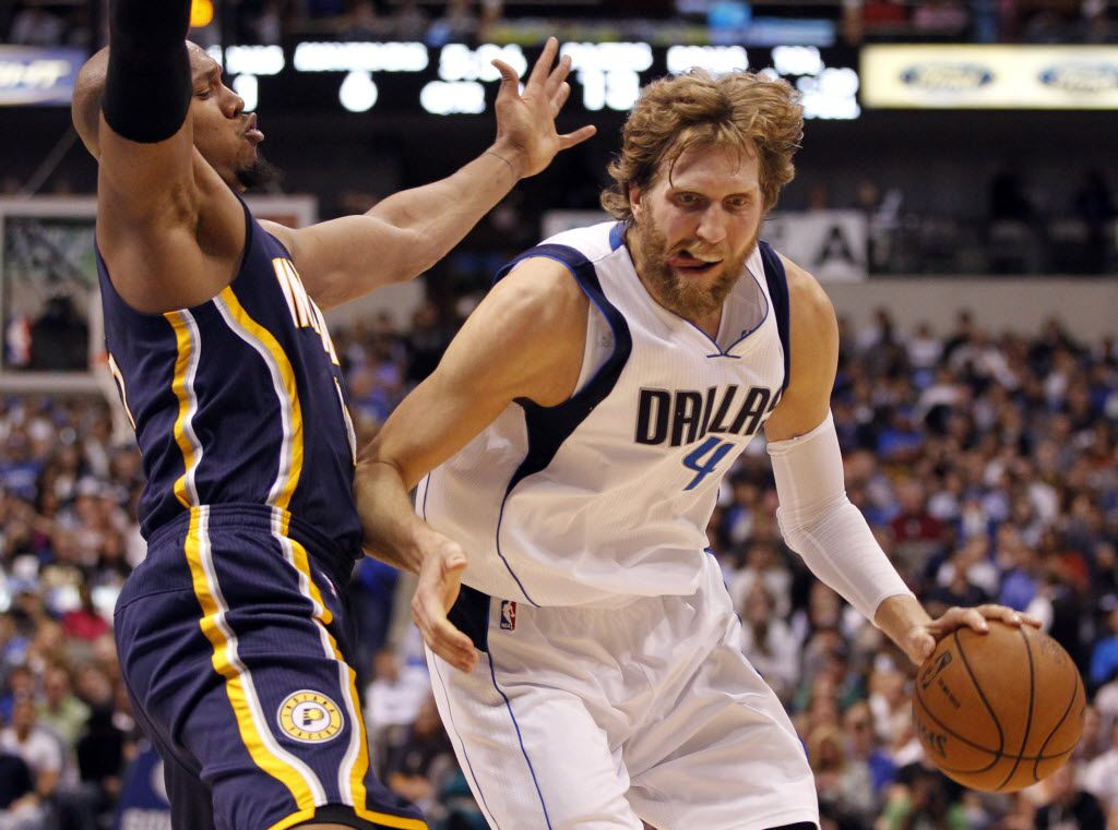 Dallas Mavericks power forward Dirk Nowitzki (41) drives on Indiana Pacers power forward David West (21) during the first half of play at American Airlines Center in Dallas on March 28, 2013. (Vernon Bryant/The Dallas Morning News)