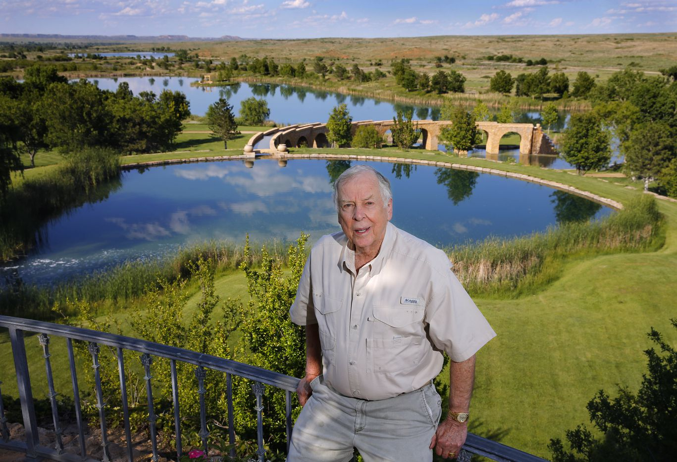 Pickens posed in 2017 at a spot overlooking a series of manmade lakes leading from The Lake House to The Lodge on his Mesa Vista Ranch in the panhandle. The ranch took nearly 10 years to build, including the stone aqueduct shown in the background.