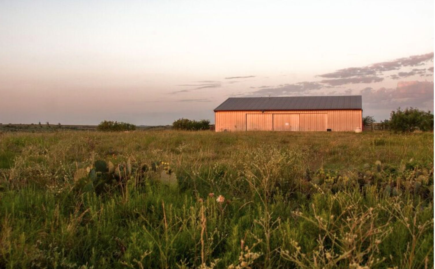 The Bear Creek Ranch includes a metal pavilion with an apartment.