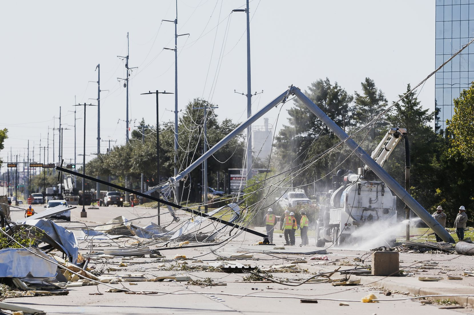 Power crews work along South Shiloh Road in Garland, Texas, on Monday, Oct. 21, 2019 after a tornado hit the night before.