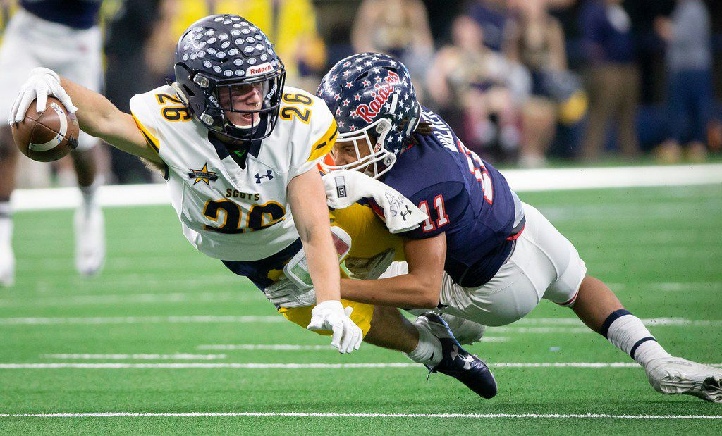 Highland Park wide receiver Ben Smith (26) dives for extra yardage as he is brought down by Denton Ryan defensive back T.J. Walker (11) during the first half of a Class 5A Division I state semifinal state semifinal at AT&T Stadium on Saturday, Dec. 15, 2018, in Arlington. (Smiley N. Pool/The Dallas Morning News)