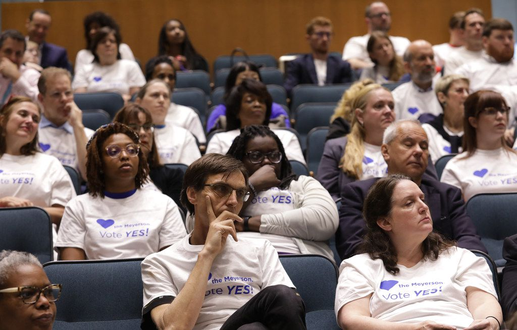 Meyerson Symphony Center supporters listen to the city council speak during a city council meeting at City Hall in Dallas, TX, on May 22, 2019.