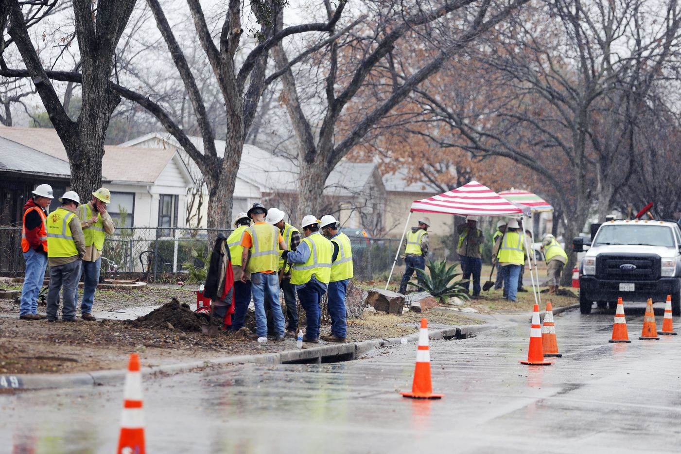 Construction crews work on gas lines near the intersection of Bowman Blvd and Chireno Street in Dallas on Wednesday, February 28, 2018. A gas leak forced the evacuation of a northwest Dallas fire station Tuesday evening not far from where a house exploded last week. (Vernon Bryant/The Dallas Morning News)
