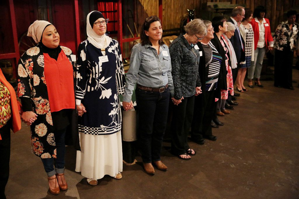 """Attendees hold hands as rabbi Nancy Kasten prays at the conclusion of the thirty-sixth annual National Day of Prayer Luncheon at Eddie Deen's Ranch in Dallas Thursday May 4, 2017. The luncheon was hosted by The Thanks-Giving Foundation and its Interfaith Council. The program was titled """"Prayer in the 21st Century: A Journey of the Timeless and Thought-Provoking."""