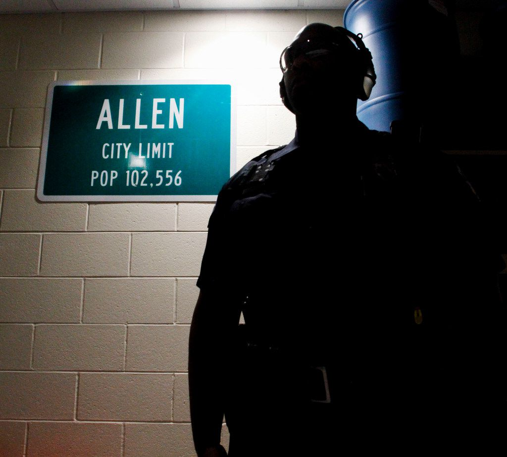 Officer Chris Johnson, a school resource officer with the Allen Police Department, watches as fellow officers sight their rifles.