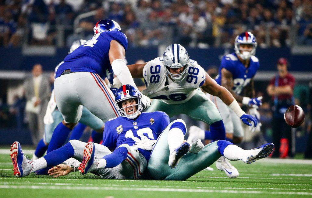 New York Giants quarterback Eli Manning (10) fumbles the ball after getting sacked by Cowboys linebacker Damien Wilson in the third quarter quarter of a game on Sunday, Sept. 16, 2018, at AT&T Stadium in Arlington. (Shaban Athuman/ The Dallas Morning News)