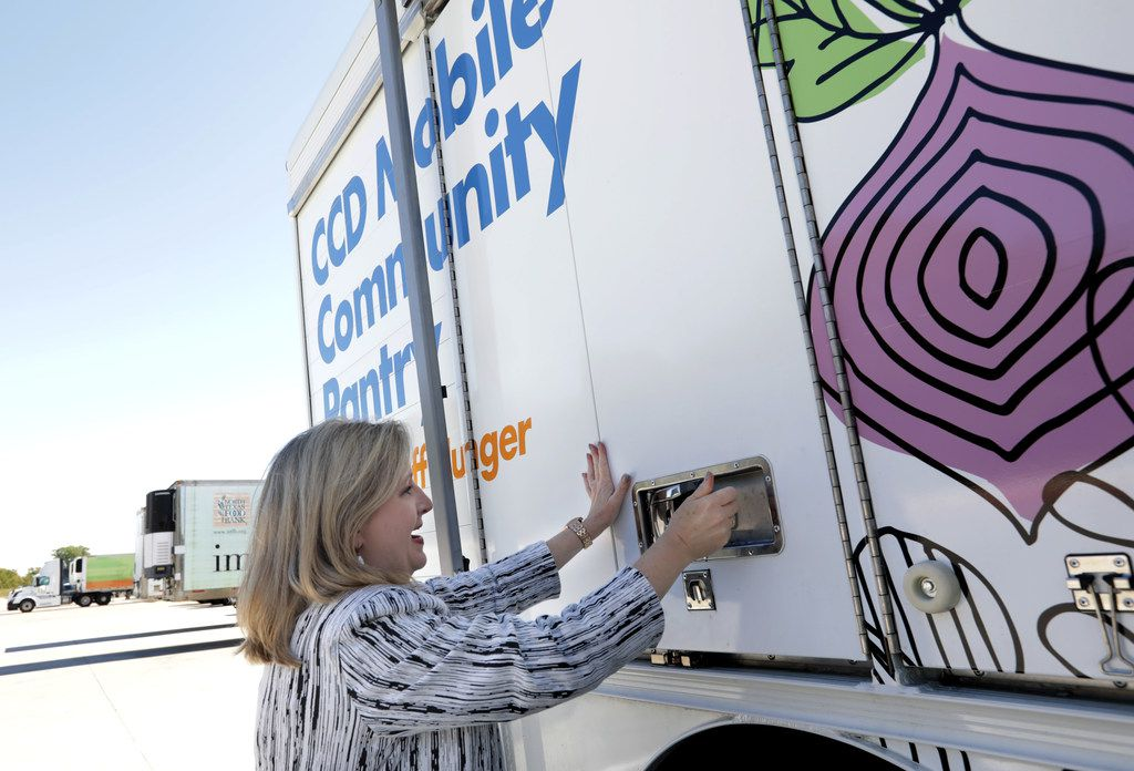 Trisha Cunningham, president and CEO of North Texas Food Bank, and one of the two Catholic Charities Dallas mobile food pantries that have been on the streets since last month