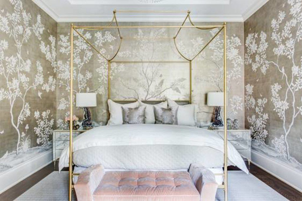Emily Johnston Larkin mixes up the shapes of pillows on a bed — usually a combination of square pillows and rectangular lumbars (or rounded bolsters) — to create a more interesting combination.