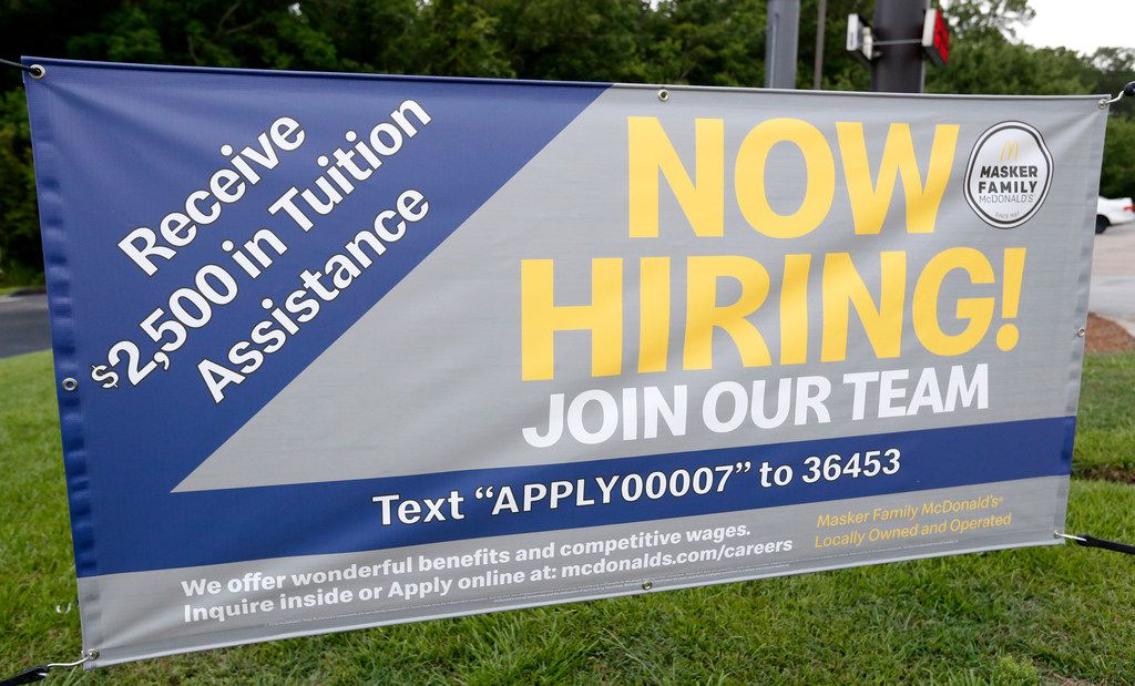 A now hiring sign boasts tuition assistance enticement to attract potential workers at this McDonald's restaurant in Moss Point, Miss.