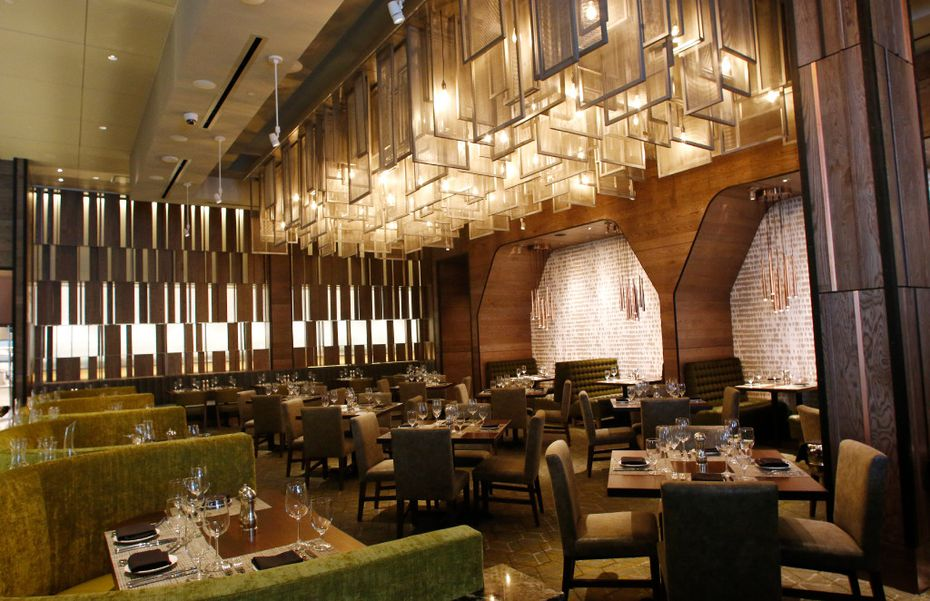 The most stylish seat in the main dining room at Del Frisco's Double Eagle Steak House in Plano is along the wall on the right, where olive-colored booths are snuggled into a modern-looking wall.