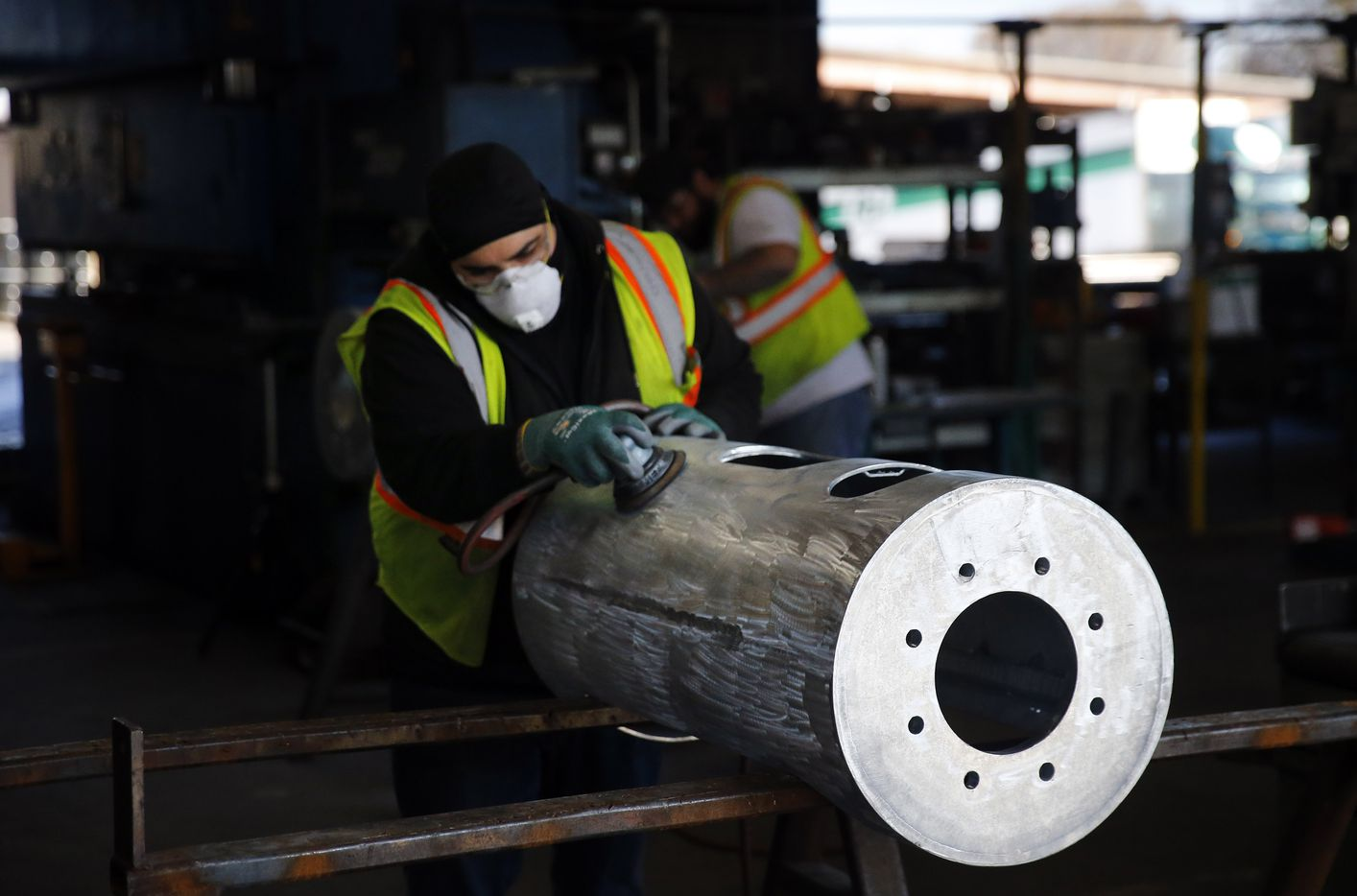A worker sands a galvanized steel housing at wireless infrastructure manufacturer CommScope in Euless, Texas, Monday, February 4, 2019. The local facility is involved in 5G deployment.