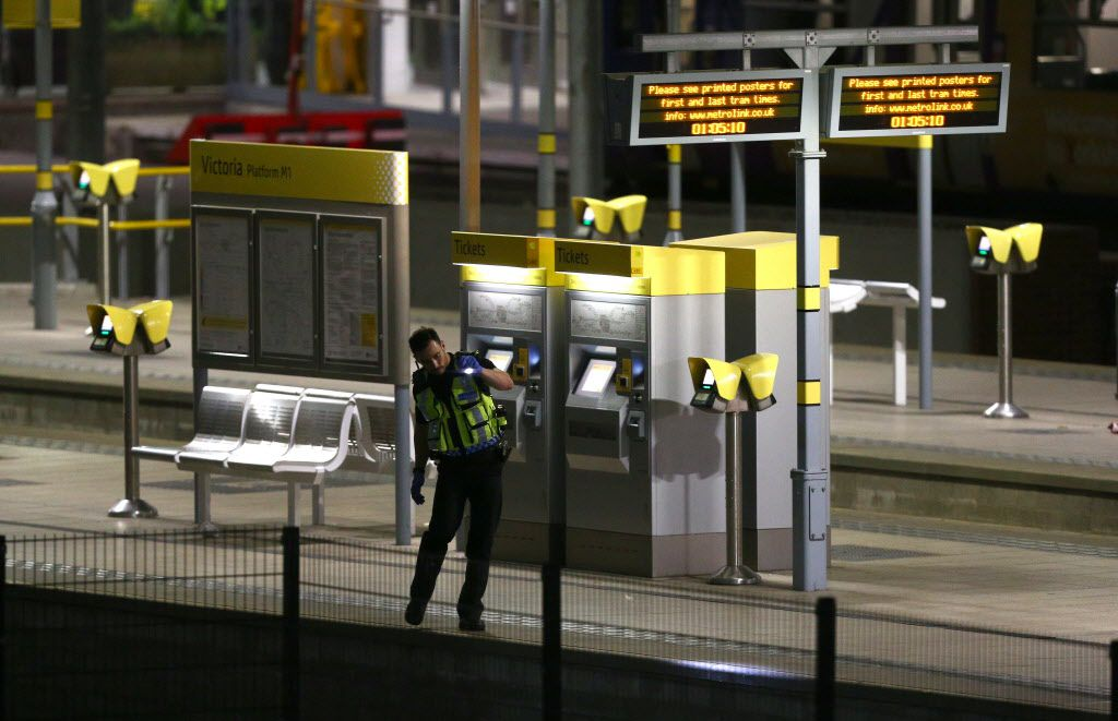 MANCHESTER, ENGLAND - A policeman patrols Victoria Railway Station close to the Manchester Arena on May 23, 2017 in Manchester, England.  There have been reports of explosions at Manchester Arena where Ariana Grande had performed this evening.  Greater Manchester Police have have confirmed there are fatalities and warned people to stay away from the area. (Photo by Dave Thompson/Getty Images)