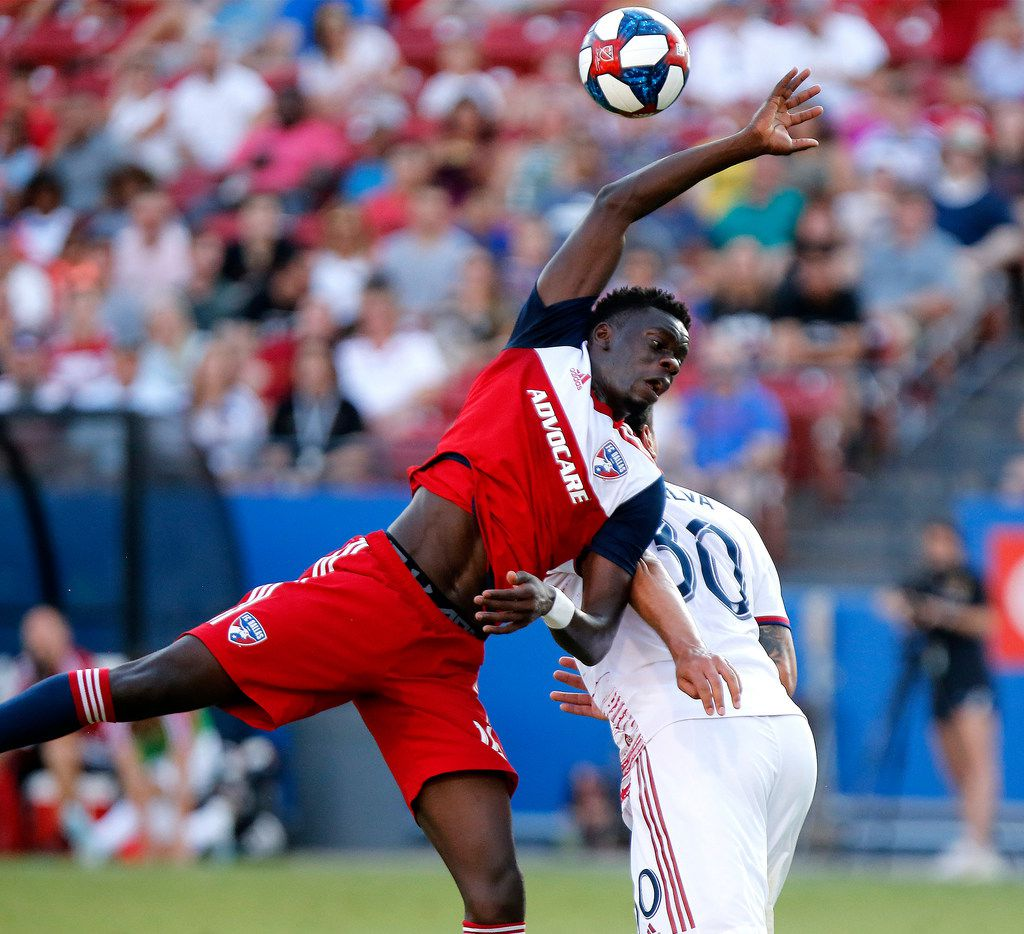 FC Dallas forward Dominique Badji, left, is unable to reach the ball over Real Salt Lake defender Marcelo Silva (30) near the goal during the first half of an MLS soccer match in Frisco, Texas, Saturday, July 27, 2019. (Stewart F. House/The Dallas Morning News via AP)