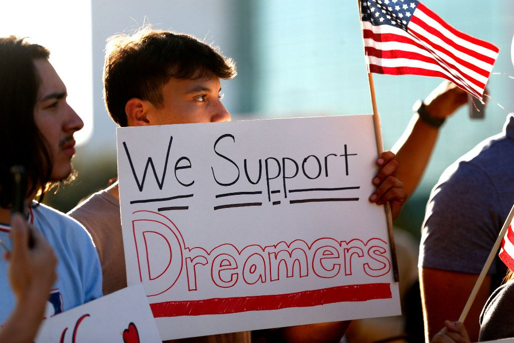 Jordin Chavez stands in the crowd with a sign during a support rally for DACA recipients at City Hall Plaza in Dallas on Sept. 6, 2017.