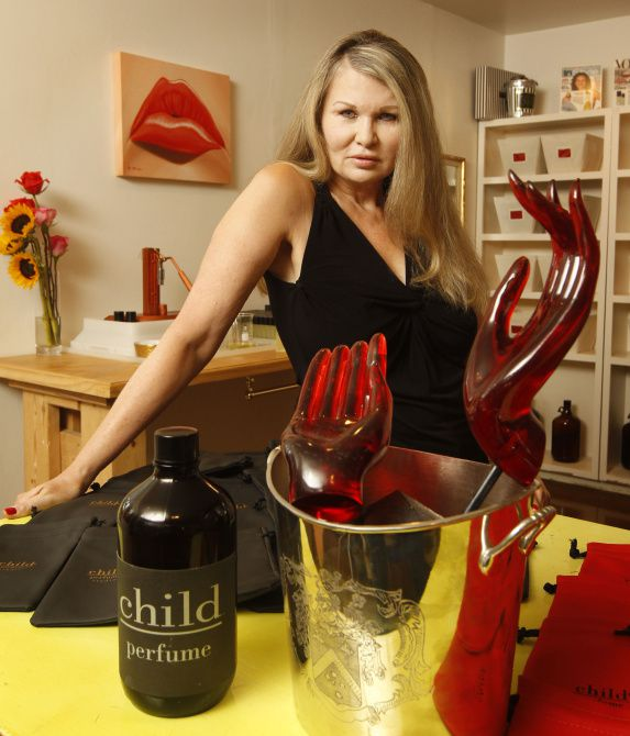 """Susan D. Owens, a former Playboy Bunny , now bottles the highly-successful perfume """"Child"""", pictured in her garage workshop in Dallas, on August 22, 2013. The fragrance is a best seller in Los Angeles Boutiques."""