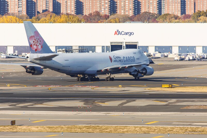 New York, NY, USA - November 3, 2013: Boeing 747 China Airlines Cargo lines up on the runway at John F. Kennedy International Airport in New York, USA on November 3, 2013. China Airlines is the flag carrier of the Republic of China - commonly known as Taiwan.