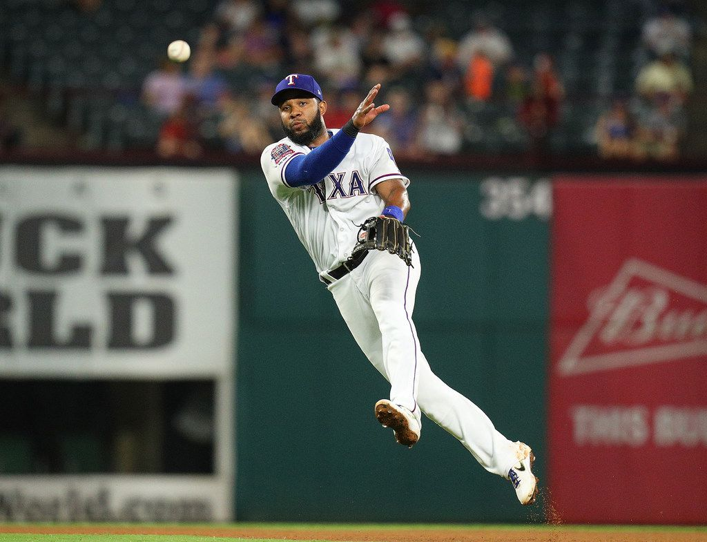ARLINGTON, TEXAS - AUGUST 30: Elvis Andrus #1 of the Texas Rangers makes the throw to first for an out in the seventh inning against the Seattle Mariners at Globe Life Park in Arlington on August 30, 2019 in Arlington, Texas. (Photo by Richard Rodriguez/Getty Images)