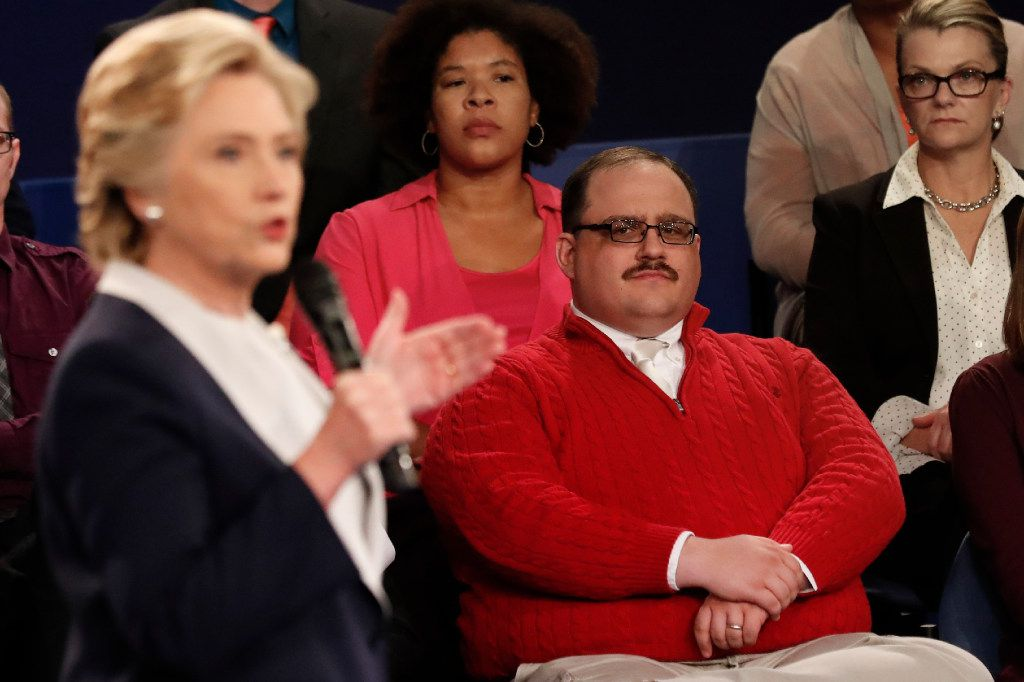 Kenneth Bone listens as Democratic presidential nominee Hillary Clinton answers a question during the second presidential debate with Republican presidential nominee Donald Trump at Washington University in St. Louis, Sunday, Oct. 9, 2016.
