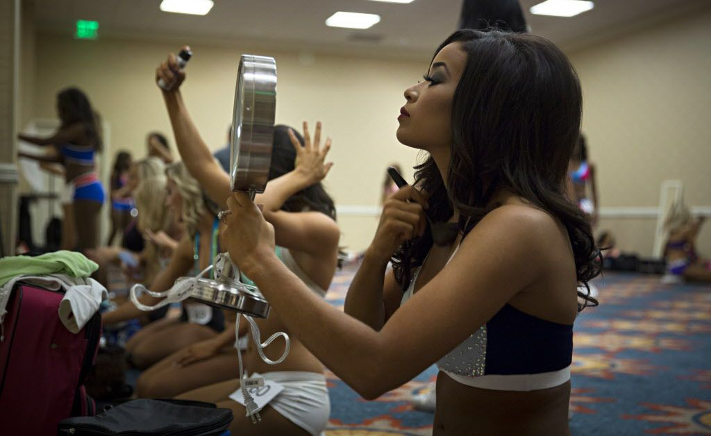 Karielle Chambers works on her makeup before final auditions to join the 2015-2016 Dallas Mavericks Dancers team Sunday, July 12, 2015 in Dallas. More than 40 women made it to the finals, vying for a spot to take part in a training camp later in the week.