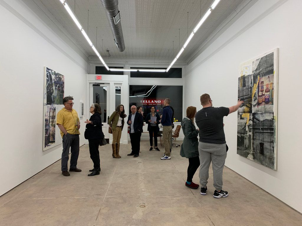 Interior at the opening of the exhibition of paintings and video works by Belgian artist collective Leo Gabin at Sean Horton (presents) on West Jefferson Boulevard in Dallas.