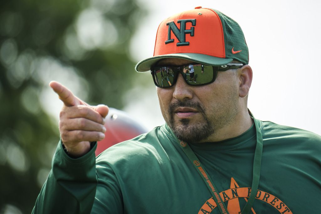 Garland Naaman Forest football coach Jesse Perales makes a point during a freshman team practice at the school on Friday, Aug. 9, 2019, in Garland. (Smiley N. Pool/The Dallas Morning News)