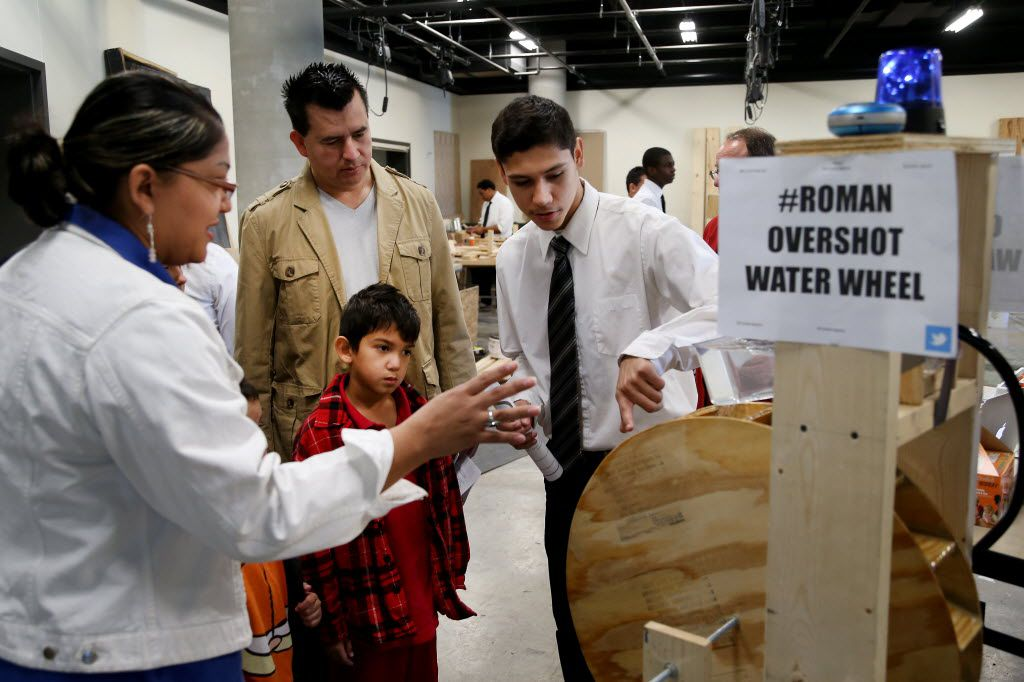 A student shows off a project during an open house at Dubiski Career High School in Grand Prairie in 2014. (DMN archives)
