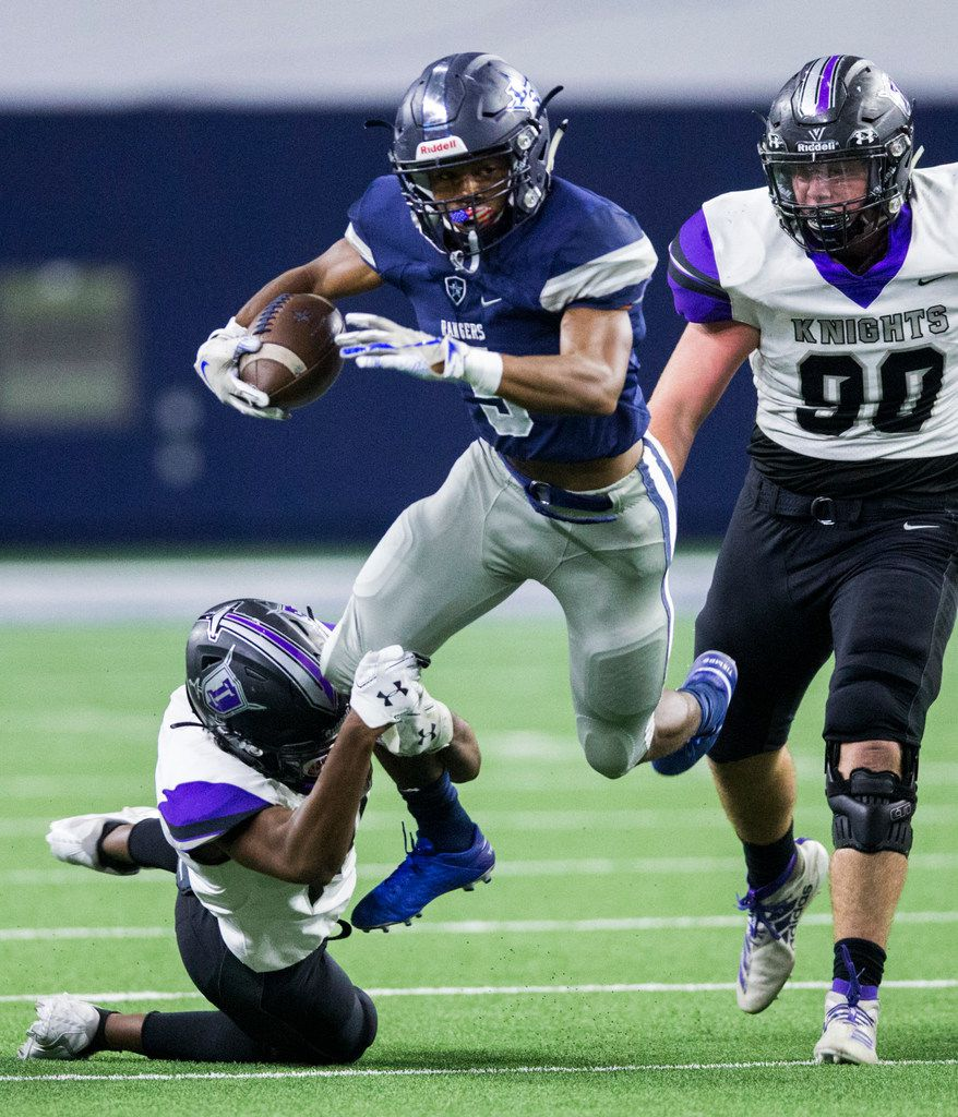 Frisco Lone Star running back Jaden Nixon (5) is tripped up by Frisco Independence defensive back Ethan Taite (18) during the first quarter of a District 5-5A Division I high school football game between Frisco Independence and Frisco Lone Star on Thursday, October 10, 2019 at the Ford Center at The Star in Frisco. (Ashley Landis/The Dallas Morning News)