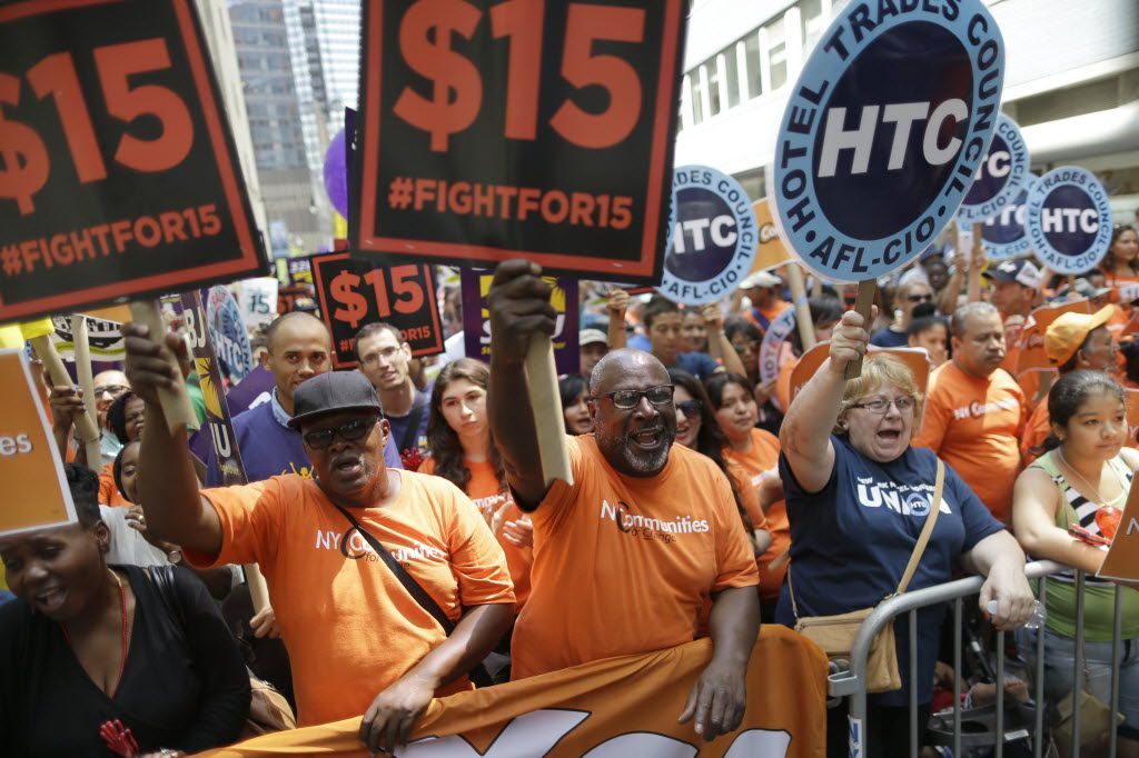 FILE- In this July 22, 2015, file photo, activists cheer during a rally after the New York Wage Board endorsed a proposal to set a $15 minimum wage for workers at fast-food restaurants with 30 or more locations in New York. The first question in the GOP presidential debate on Tuesday, Nov. 10, 2015, whether the minimum wage should go to $15 an hour, showed that U.S. workers have managed to thrust the issue of pay onto the presidential campaign agenda. (AP Photo/Mary Altaffer, File)