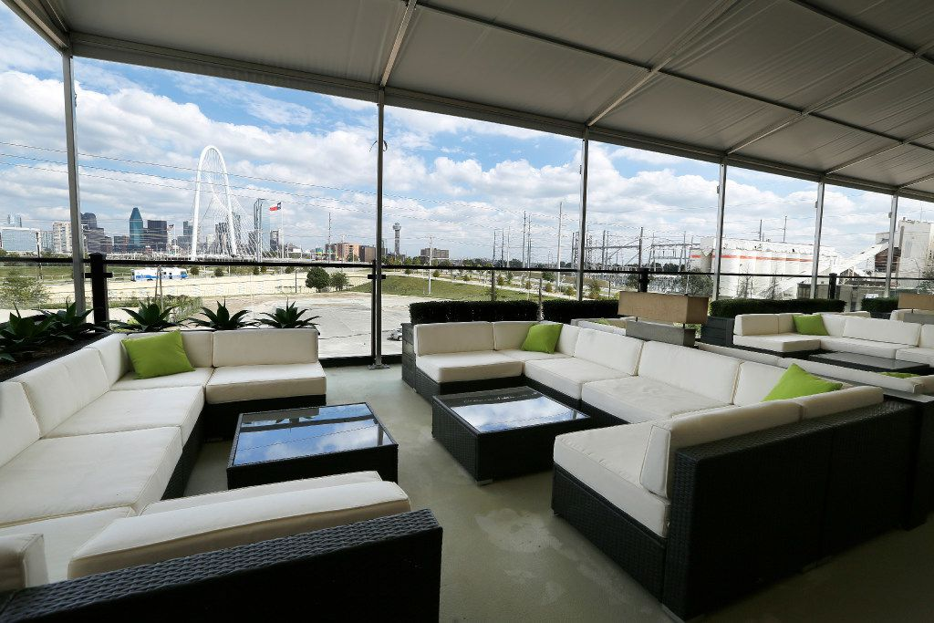 Saint Rocco's covered rooftop lounge has a view of the Dallas skyline.