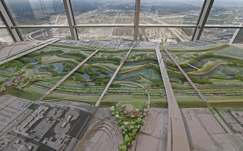 A model of the Trinity River Park plan sits in front of a view showing the Trinity River area at the City Club in Dallas, Thursday, May 19, 2016. (Jae S. Lee/The Dallas Morning News)